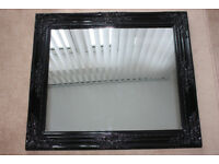 Mirror in wooden black lacquered ornamental frame, 72 x 63cm