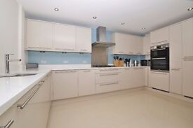 A four bedroom modern town house situated within a desirable gated development