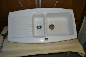 White porcelain 1 ½ bowl sink and mixer tap