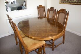 Walnut Effect Dining Chairs and Carvers. Cane back with upholstered seats.