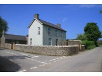 Fronygarth - a peaceful residence in a rural location with distant sea views.