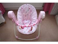 Bright Starts Anywhere Portable Swing from the Pretty in Pink range