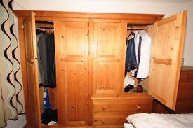 4 door pine wardrobe with 2 drawers, good condition, will go flat pack