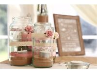Glass Jars with lace, ribbon and candles for wedding or event