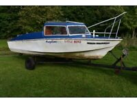 16ft fiberglass Microplus fishing boat with 20hp Johnson outboard and trailer. listed on Ebay.