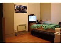 Renovated top floor apartment has been tastefully refurbished to give an open plan .