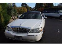 White Lincoln Limousine Excellent condition Low Miles.