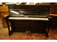 New black upright piano. Tuned with UK delivery available. FREE matching stool!