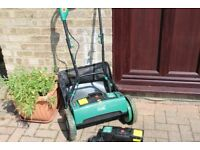 Cordless Lawn Mower with extra battery pack and charger