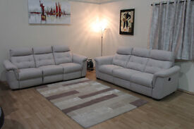 Ex-display Designer cream plain fabric electric recliner pair of 3 seater sofas