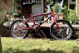 Free red child's first bike. Needs some TLC!