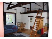 A furnished studio flat, which is the annexe of a farmhouse on the edge of Wiveliscombe