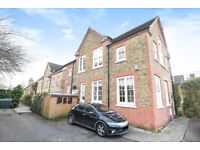 A fantastic three-bedroom, semi-detached mews house with a private patio garden