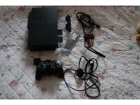 A PS2 and Slimline PS2 with games