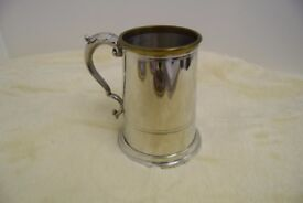 a lovely Pewter tankard, brass lipped. new (boxed)