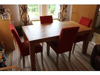 Oak veneer dining table with 4 red Harlow chairs fabric cover. Excellent quality and sorry to sell.