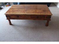 Large solid wood coffee table. Great condition and a real bargain.