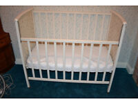 White Traditional Wooden Drop-side cot with Mattress.