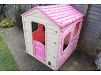 plastic playhouse in pink