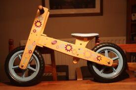 Childrens wooden balance bike