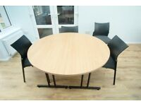Light coloured, wood effect, round/oval table in three pieces plus chairs