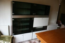 2 white display cabinets