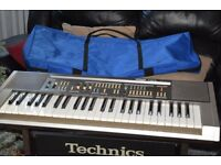 HOHNER KEYBOARD/CARRY CASE/HOHNER AMP/WIRES CAN BE SEEN WORKING