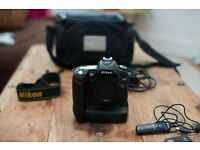Nikon D90 with battery grip, two batteries remote control, cable release and bag