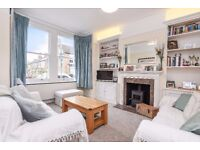 A beautifully presented four bedroom family house to rent on this popular Southfields street
