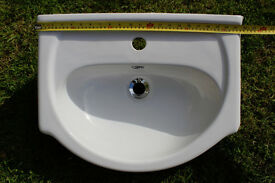 White hand basin suitable for a vanity unit. Use with a mono block tap