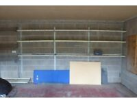two sets of heavy duty wall mounted steel shelving suitable for garage or workshop