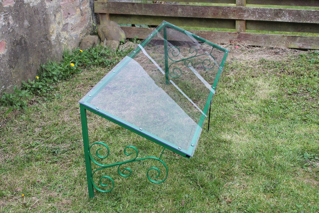 PORCH/DOOR CANOPY - WROUGHT IRON FRAME - THICK PERSPEX ROOF APPROX 7 FEET LONG & PORCH/DOOR CANOPY - WROUGHT IRON FRAME - THICK ...