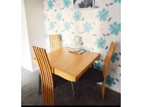 Solid oak dining table and 4 chairs (extendable)