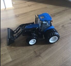 New holland large tractor with lights and sound.