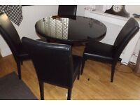 Black Circular Dining Table ( Wooden top with glass on ) with 4 Leather-Look Chairs