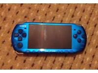 Psp console with job lot 27 games 5 movies