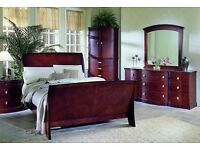 Dark wood double bed for sale.
