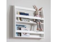 Wall mounted book case in white. New in box.