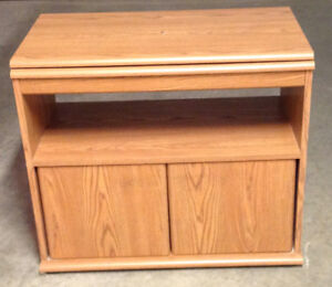 TV stand with swivel top and storage space. Wood panel.