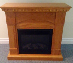 Mint condition, solid oak electric fireplace