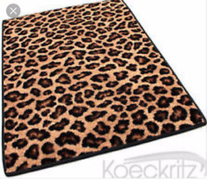 WANTED ANIMAL PRINT AREA RUG