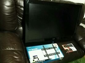 42 inch TV new TV bracket new remote perfect working order has scratch on screen hence price