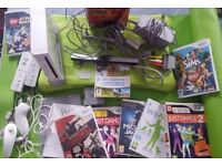 Nintendo Wii with games and Wii Fit accessories