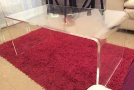 Thick glass contemporary coffee table with 3 matching nest of tables .