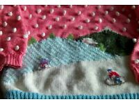 """Hand knitted children's jumper, motif is of a snowy scene with children tobogganing. Chest size 36""""."""