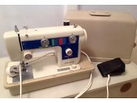 New Home Electric Sewing Machine in case