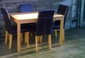 Table & 4 Leather chairs, in excellent condition, can deliver.