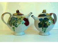 A pair of matching teapots