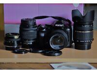Pentax K-r DSLR Camera (black), 4 Lenses, 2 batteries, AA battery holder, Charger, User manual(CD).