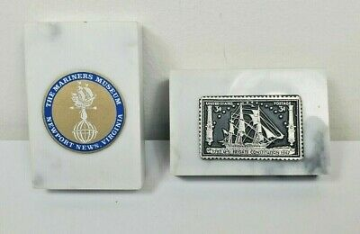 Two Marble base paperweights Mariners Museum and USS Constitution postage stamp
